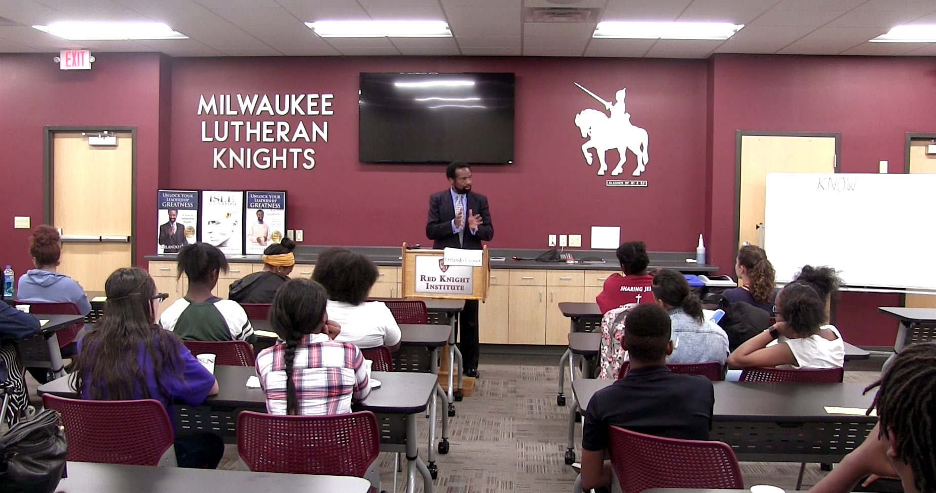 Author and motivational speaker Orlando Ceaser addresses the Business Club at Milwaukee Lutheran High School on Sept. 5. The club currently has 54 members.