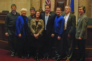 Son Paul (center) is sworn in at the state Senate in 2013. FARROW FAMILY PHOTO