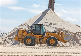 The Fairwater Sand Plant is Badger Mining Corp.'s oldest sand mine. A loader hauls sand from the stockpile to the dry plant. Photo by Jeffrey Phelps