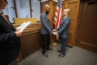 Corey Dillard (left) and Jared Shah exchange vows on March 9 at the Milwaukee County Courthouse. Photo by Jeffrey Phelps