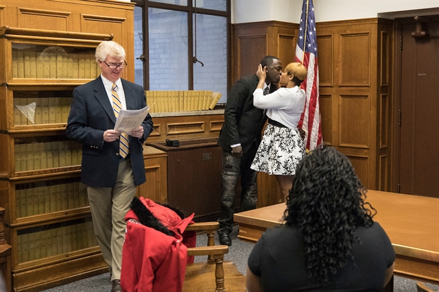 Damien Nelson and Dalicha Whitelow tie the knot on March 9 at the Milwaukee County Courthouse as family members look on. Photo by Jeffrey Phelps