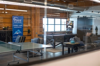 MLG's millennial-friendly employee lounge offers pool, ping pong, air hockey and pinball.  Photo by Jeffrey Phelps.