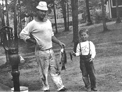 In 1949, Mike, 7, and his beloved uncle, Dan O'Connell, display their day's catch. Mike spent 11 summers up north helping his uncle restore and run a resort. Mooney family photo.