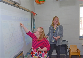 Federal paperwork added so much to Holly Ashton's teaching workload that she gave up teaching to become a teacher's aide in the D.C. Everest Area School District near Wausau. Photo by  Jill Mabry.