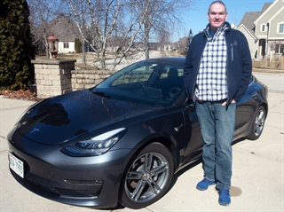 Chris Lundh, of Waukesha, had to travel to Highland Park, Illinois, to pick up the Tesla Model 3 that he ordered. Photo by Allen Fredrickson.