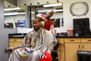 Albert Walker continues to grow his Imago Dei Barber Lounge in Green Bay and recently set up shop at the city's Farmers' Market on Broadway. He is pictured here with client Mike Daniels, Green Bay Packers defensive end, at the shop in 2017. Photo by Jeffrey Phelps.