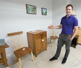 Ian shows some of hishandmade furniture that fits in the Shaker style with a nod to Arts and Crafts. Photo by Gary Porter.
