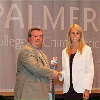 Mikhaila Weister appears at her white coat ceremony, which marks the transition from preclinical to clinical studies.