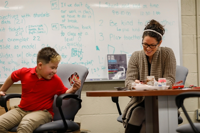 "Principal Julieane Cook of St. Martini Lutheran School in Milwaukee takes time out twice a day from her administrative duties for ""sensory breaks"" – where she and special education students play games, practice social skills and work on occupational therapy. Photo by Jeffrey Phelps."