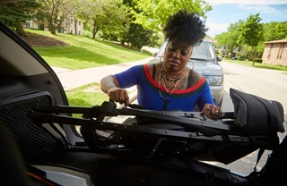 Sharon Hudson of Shearz Hair Artistry brings her mobile salon to a client's home in Milwaukee. Under licensure reforms passed in 2017, beauty professionals can provide services outside of salons to all customers, not just the homebound or institutionalized. Photo by Darren Hauck.