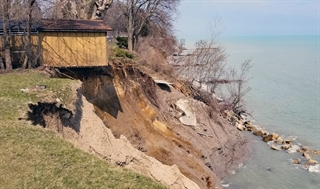 A homeowner's shed in Somers in Kenosha County teeters on a bluff eroded by high water levels in Lake Michigan in April 2019. By October, the shed had toppled off the bluff.
